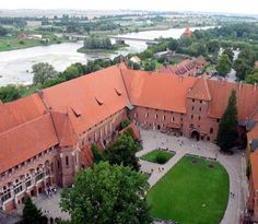 THE MALBORK CASTLE IN POLAND.  TheCastle of the Teutonic Order in Malbork, Poland is the largest castle in the world by surface area, and the largest brick building in Europe.  It was built in Prussia by theTeutonic Knights, aGermanRoman Catholic religious orderofcrusaders, in a form of anOrdensburgfortress. The Order named itMarienburg(Mary's Castle). The town which grew around it was also named Marienburg.  Thecastleis a classic example of a medievalfortressand, on its…