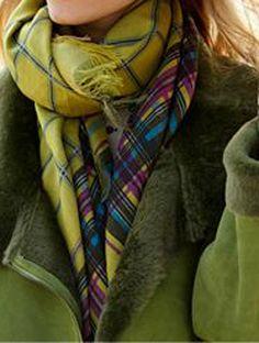 Tatum Shearling coat and green tartan scarves.
