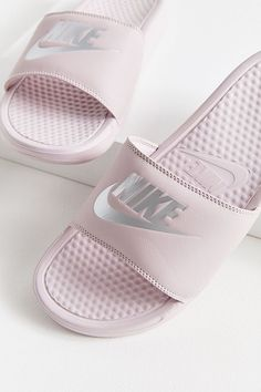 Nike Just Do It slides are equipped with massaging texture foot beds phylon cushion soles to give your feet some much needed post-workout TLC #women #shoes #footwear #product #shoe