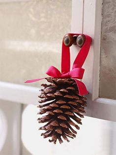 pine cone with red ribbon