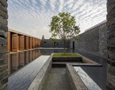 Chinese studio Neri&Hu has completed a boutique hotel in Yangzhou comprising a grid of dark-brick walls that surround a series of courtyards and gardens.