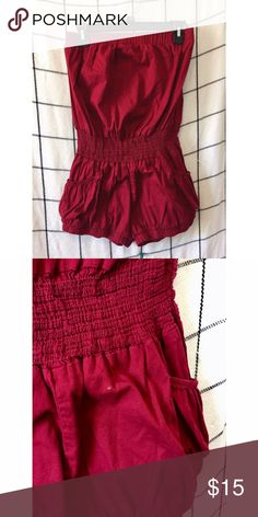 BOUTIQUE // Strapless Romper Strapless red romper with pockets. Has small stain on bottom (pictured). Stretchy material. NOT FREE PEOPLE: for exposure. Free People Pants Jumpsuits & Rompers
