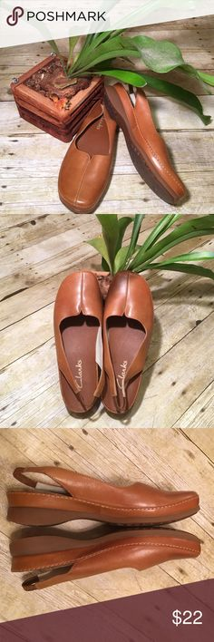 """ClarksSlide Slingbacks Warm Caramel 7 1/2 W Such a nice pair of shoes. Nice wide toe box. They have a 2"""" wide elastic strap in the back. It is 3/8"""" high. Nice non slip rubber sole with flowers!! Leather uppers. As with all leather, there are color variations. They have very minor scuffs. Non smoking home Clarks Shoes"""