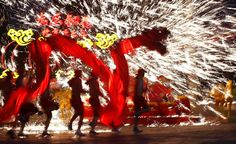 BEST PICTURES OF 2014 | ©  Kim Kyung-Hoon/Reuters  Beijing, China, Dancers perform a fire dragon dance in the shower of molten iron spewing firework-like sparks during a folk art performance to celebrate the traditional Chinese Spring Festival on the first day of the Chinese Lunar New Year, which welcomed the Year of the Horse, at the Happy Valley amusement park in Beijing on January 31.