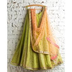 """Mint green lehenga with peach choli perfect combination for this season…"