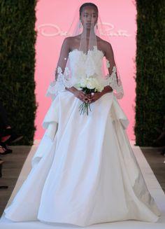 To see more gorgeous Oscar de la Renta wedding dresses: http://www.modwedding.com/2014/11/16/flashback-best-oscar-de-la-renta-wedding-dresses/ #wedding #weddings #wedding_dresses