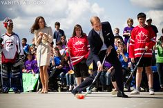 "Dressed in his best athletic suit, the Duke of Cambridge tried his hand at street hockey, or ""shinny,"" with locals."