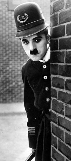 "Charles Chaplin (1889–1977) as policeman in ""Easy Street"", 1917, age 28"