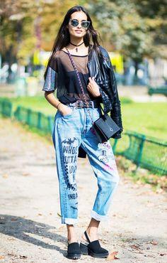 Gizele Oliveira wears a sheer top, cropped jacket, custom cuffed jeans, slingback heels, and a black choker