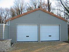 Garage En Bardage Clin Composite Avec Double Portes De Garage