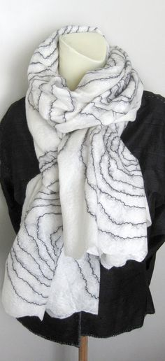 Hand felted scarf made with super soft merino (18 micron) wool and silk. Cobweb felt is lightweight, warm, soft and lacy, holes are part of the design. Approximate measurements: 82 x 27. Hand wash in cool water, squeeze gently (dont wring) dry flat on a towel. Buy this scarf - get 15% off this clutch: http://www.etsy.com/listing/67492768/handbag-clutch-hand-felted-black-white Ill ship the item within 48 hours from payment to the address you provide during your...