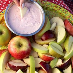Blend 12 ounces reduced-fat whipped cream cheese with 3 tablespoons seedless raspberry preserves until smooth. Serve with apple wedges.