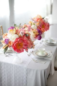 Lovely, romantic wedding centerpiece, coral charm peonies, peach and sherbet, crystal cut pedestal vases, lace runner  @Fleur @Ami @ EAD