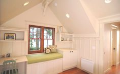 Arts and crafts style wainscoting, built-in desk, window seat -- Craftsman-style Doe Bay Cottage by Method Home and Studio 29 -- prefab house -- green / eco / sustainable building