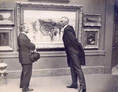Palace of Art. Two visitors viewing painting at the 1904 World's Fair. (St. Louis Art Museum)