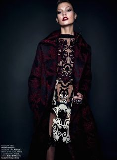 Karlie Kloss in a Vitorinos Campos coat and Animale dress photographed by Henrique Gendre for Vogue Brazil, July 2014.