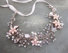 This beautiful wire hair vine, available in gold, rose gold and silver is a lovely finishing touch for the boho chic bride. A mix of clear crystals and acrylic pearls are set throughout with 4 pearl encrusted flowers and enamel leaves accenting the piece for a textured vintage feel. MEASURES Approx. 10.25 long. (This is a Half Halo - does not go all the way around) Longer sizes available. see below.  AVAILABLE COLORS: - Silver - Gold - Rose Gold (see last photo for options)  HOW TO WEAR…