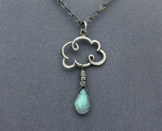 This rain necklace is made with a solid sterling silver, puffy cloud charm, a gorgeous genuine blue flash labradorite briolette, sterling