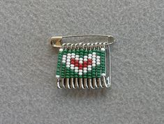 Green, White, and Red Heart Beaded Safety Pin. $3.50, via Etsy.