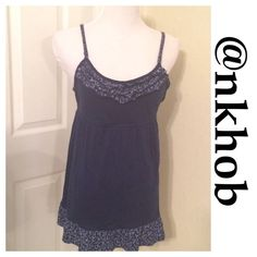 SO Babydoll Top Adjustable strap Babydoll top.  Ruffles on the bodice. Tie back, ruffle bottom. Very feminine very light.  navy with white print EUC (A) SO Tops Camisoles