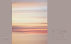 September 2016 calendar featuring an abstract beach sunrise photograph in pink, blue, and soft yellow. Download yours for your desktop wallpaper.