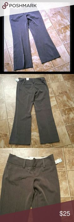 "Maurices Grey Dress Pants Gray 3/4 NWT $36 Slacks Maurices Grey Dress Pants, size 3/4 short, still new with tags.  Price on the tag says $36. Machine washable.  Laying flat,  they measure 16"" across the waist,  29.5"" inseam, 38"" long.    Smoke free home. I will gladly bundle items to give you a discount (the more you buy, the cheaper I can let everything go!). Many items can be added on for only $1.  MAKE AN OFFER! Maurices  Pants Boot Cut & Flare"