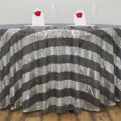 """120"""" Premium Stripe SEQUIN Round Tablecloth For Wedding Banquet Party - Silver / Black / A Duchess is a lady whom stands a head above the rest. She is known for her leadership, charm and peerless sophistication. Every lady wants to be her because everything she does is both elegant and filled with grandeur.  And when the Duchess puts out an invite, she is sure to make her feast / celebration / announcement truly a feat of imagination. She transforms a plain table with her Luxury Sequin Round…"""