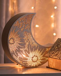 This crescent moon light is handmade with a hand-curved balsa rim. Laser-cut with an original crater design, this light gives a soft glow that will add warmth to any space.  --------------------  S P E C I F I C A T I O N S :  11 diameter x 3 deep 28 cm diameter x 7.6 cm deep  Hight quality Baltic Birch plywood face Curved Balsa rim Natural bare wood finish Intended for indoor use  Light fixture: 55 (1.6 m) cord with rolling switch Clips in and is easily removable UL rated 110v White or…