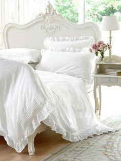 Elegant, ornate, white bedroom, headboard, bedding, French inspired, wood floors, feminine, antique