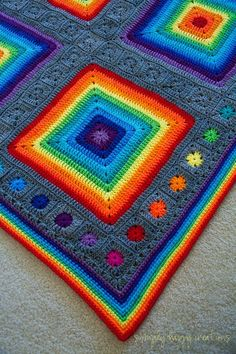 Crochet Blanket Patterns I love making pixel-art blankets; but after the holidays I needed to make something different. Something bright and colorful. Crochet Afghans, Crochet Granny Square Afghan, Crochet Squares, Crochet Blanket Patterns, Knitting Patterns, Crochet Blankets, Granny Squares, Square Blanket, Rainbow Crochet
