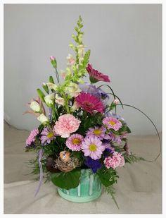 Log Cabin Florist Bakersfield Ca. See More. Spring Bouquet In A Basket. Log  Cabin Florist