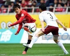 Toshiyuki Takagi of Urawa Reds shoots at goal during the J.League match between Urawa Red Diamonds and Matsumoto Yamaga at Saitama Stadium on April 4, 2015 in Saitama, Japan.