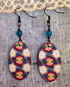 A personal favorite from my Etsy shop https://www.etsy.com/listing/275750242/up-cycled-floral-decoupage-earrings