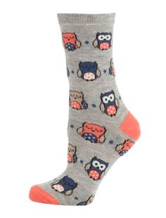 I own a bunch of pairs of printed socks. One of the pairs is also gray, but has dinosaurs instead of owls.