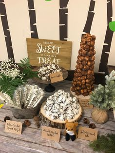 Woodland theme Dessert table with crinkles, Donut Croquembouche, Brownie Truffles, abd Chocolate dipped pretzels