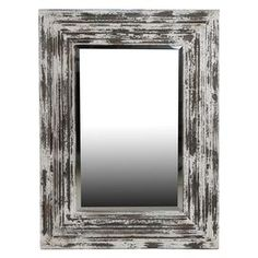 """Wall mirror with a wood frame.  Product: Wall mirrorConstruction Material: Wood and mirrored glassColor: Distressed whiteDimensions: 39"""" H x 29"""" W x 3"""" D"""