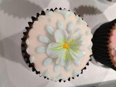 Blue Flower on White Cupcake by Mini's Bakery