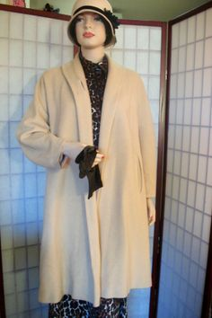 Hey, I found this really awesome Etsy listing at http://www.etsy.com/listing/116686941/vintage-cashmere-swing-coat-beige-camel