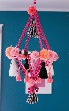 Isn't this adorable? You're looking at a chandelier mobile made from pom-poms and tassels. It's supposed to be for a nursery, but we can think of plenty of adults who'd want this.  PS you can get a tutorial here.