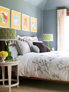 Bright Spot...Yellow matted prints bring attention to the bed, casting it as the bedroom's focal point.