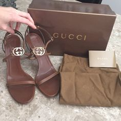 Authetic Gucci Brown Strappy Heel with Metal GG 100% Authentic. Size 7B. 4 inch heel. Wear is as seen in pictures. Includes box, 2 shoe dust bags and cards of authenticity. No trades. Gucci Shoes