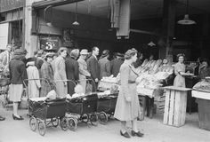 Women queuing for food, Wood Green, North London, 1945.
