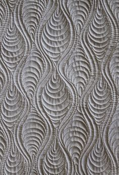 Wavy line quilting design by Angela Walter. Nothing adds movement to a quilt like wavy line quilting.