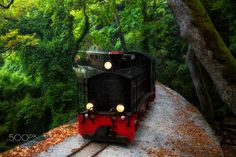 """Moutzouris - The historic railroad Volos - Milιes, the train of Pelion, as it is better known, was constructed in two stages from 1894 until 1903. The now legendary """"Moutzouris"""" linked the commercial and industrial center of Volos with the fertile and rich area of West Pelion, slopes and olive groves of the mountain of centaurs.  Until 1950 o train with the Belgian engines """"Milaiai"""" """"Jason"""" """"Pelion"""", """"Volos"""", """"Tsagarada"""" and vagonakia of with smaller engines also serving the needs of the…"""