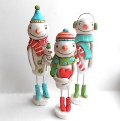 Winter Snowman with Heart in Red White Green and Turquoise Original clay folk art sculpture. $50.00, via Etsy.