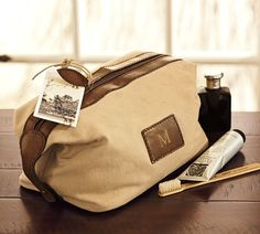 And yes, get it monogramed... it looks awesome. Saddle Dopp Kit   Pottery Barn