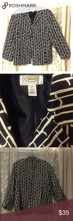 Silk jacket by Talbot's petites, plus size 16 Snap up this Snappy black and cream graphic design, pure silk jacket. Goes from work to an evening out. 4 button lapel front and three-quarters length sleeve transition through all Seasons. Nicely cut and in excellent condition. 100% silk over a full polyester lining. Jacket is in like new condition with no signs of wear. Talbots Jackets & Coats Blazers