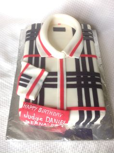 Burberry inspired cake which I made for my client who ordered it for the 80th birthday of the father of her boyfriend. Cake is made of moist chocolate and covered with fondant.