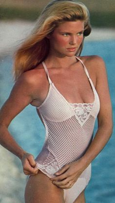 1978 Sports Illustrated Swimsuit. Photographed by: Walter Iooss, Jr. Christie Brinkley appears in the pink for an early morning dip at Bahia's Lake of Tears. Her net and lace maillot is by Monika for Elon