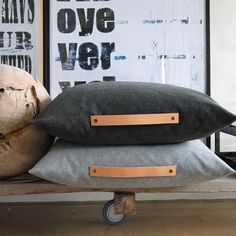 Poppytalk: 12 Leather-Inspired DIYs + Ideas to Try: wool pillows with leather straps as handles
